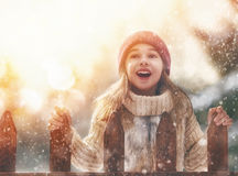 Girl playing on a winter walk Royalty Free Stock Photo
