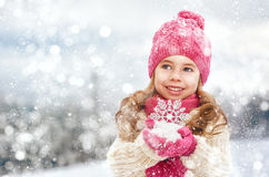 Girl playing on a winter walk Royalty Free Stock Image
