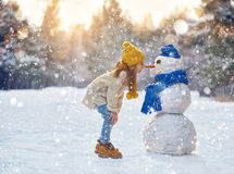 Free Girl Playing With A Snowman Royalty Free Stock Image - 63205906