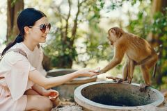 Free Girl Playing With Monkey Stock Images - 122767394