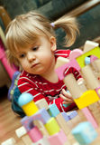 Girl playing with wood blocks Stock Photo