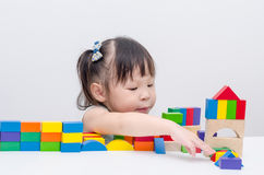 Girl playing wood blocks Stock Images