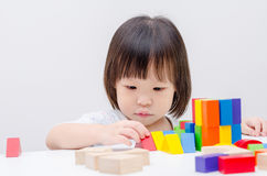 Girl playing wood blocks Stock Photography