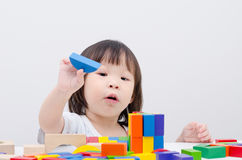 Girl playing wood blocks Royalty Free Stock Images