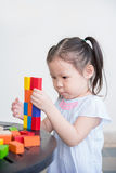 Girl playing wood blocks Stock Image
