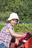 Girl playing in wooden car Royalty Free Stock Photos