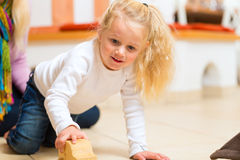 Girl playing wooden toy car Royalty Free Stock Photography
