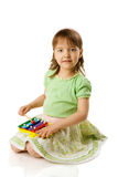 Girl playing on xylophone Royalty Free Stock Photo