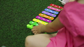 Girl playing the xylophone close-up Stock Photography