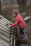 Girl playing a xylophone in a garden Stock Images