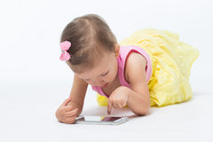 Girl playing on your phone Stock Photos