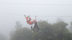 Girl playing zipline in the mist. At tumbon Thep-sadet Doisaket Chiangmai Thailand, 1st January 2017 Royalty Free Stock Photography