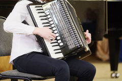 Girl plays the accordion Stock Photography