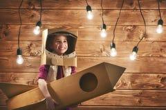 Girl plays astronaut Royalty Free Stock Photos