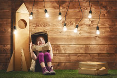 Girl plays astronaut Royalty Free Stock Image
