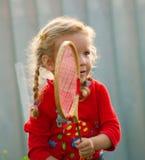 Girl plays in badminton Royalty Free Stock Image