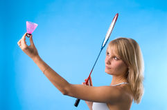 The girl plays badminton. The girl in a light vest is going to make serve Stock Image