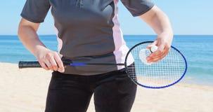 A girl plays badminton on the beach. Royalty Free Stock Photos