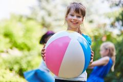 Girl plays with ball royalty free stock photo