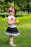 Girl plays with ball Royalty Free Stock Photos