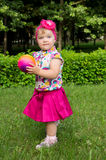 Girl plays with ball Royalty Free Stock Images