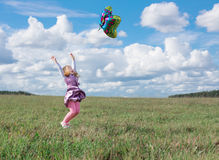 girl plays with  balloon in grass Royalty Free Stock Photo