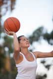 Girl plays basketball Royalty Free Stock Images