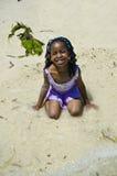 Girl plays at a beach. A girl plays on a sandy tropical beach Royalty Free Stock Photo