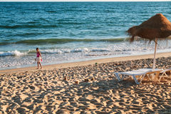 Girl plays on beach Praia Falesia near Albufeira Stock Photography