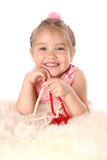 Girl plays with beads and smiling Stock Image