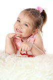 Girl plays with beads and smiling Royalty Free Stock Photo