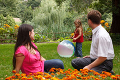 Girl plays with big inflatable ball in park Royalty Free Stock Image