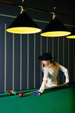 The girl plays billiards Royalty Free Stock Photo
