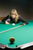 The girl plays billiards Stock Photo