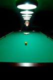 The girl plays billiards Stock Photos