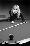 The girl plays billiards Royalty Free Stock Photos