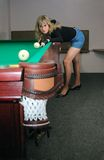 The girl plays billiards Royalty Free Stock Photography