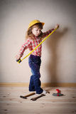 girl plays in the builder Stock Image