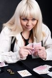 A girl plays in a casino Royalty Free Stock Photos