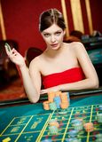 Girl plays at the casino club Royalty Free Stock Photography