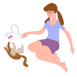 Girl plays with cat. Young girl sits on floor and plays with cat by thread and red bow. She love her cat and enjoys play. Cat  lies on back and tries to catch Royalty Free Stock Images