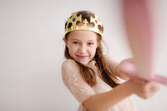 The girl plays a cheerful game. The joyful girl plays a game at home Royalty Free Stock Photos
