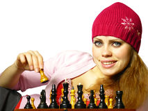 Girl plays chess. Chess of game of the girl on a white background Royalty Free Stock Photos