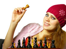 Girl plays chess on a white background. Chess of game of the girl on a white background Royalty Free Stock Images