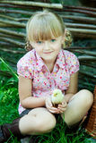 Girl plays with chicken Royalty Free Stock Images