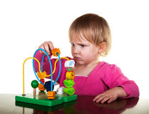 Girl plays with colorful education wooden toy Royalty Free Stock Images