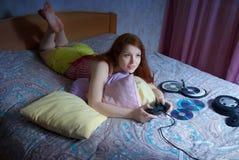 A girl plays a computer game Stock Photos