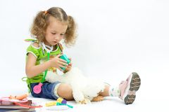 The girl plays doctor. With toy tools Stock Images