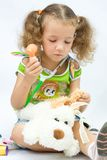 The girl plays doctor. With toy tools Royalty Free Stock Image