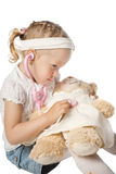 Girl plays doctor Royalty Free Stock Photos